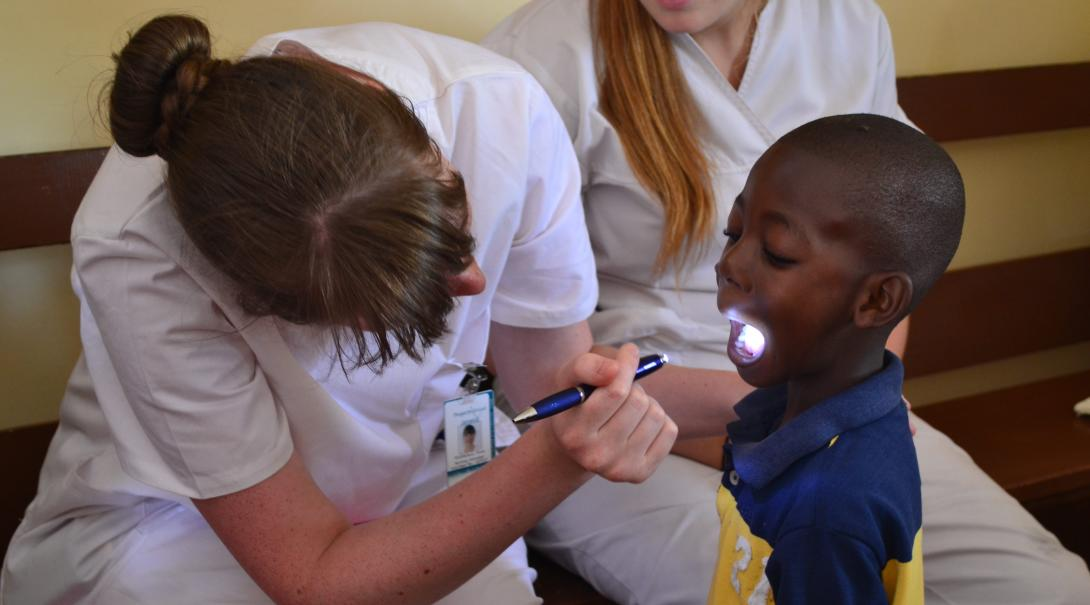 Projects Abroad volunteers doing a dentistry internship with Projects Abroad in Ghana do dental checks.
